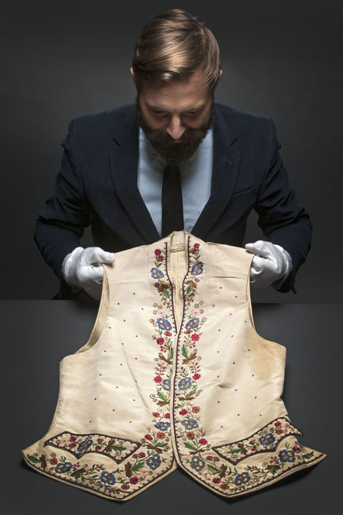 Fashion Curator, Timothy Long, with a 1895 waistcoat